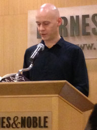 Max Barry speaking at a podium at Barnes and Noble, New York